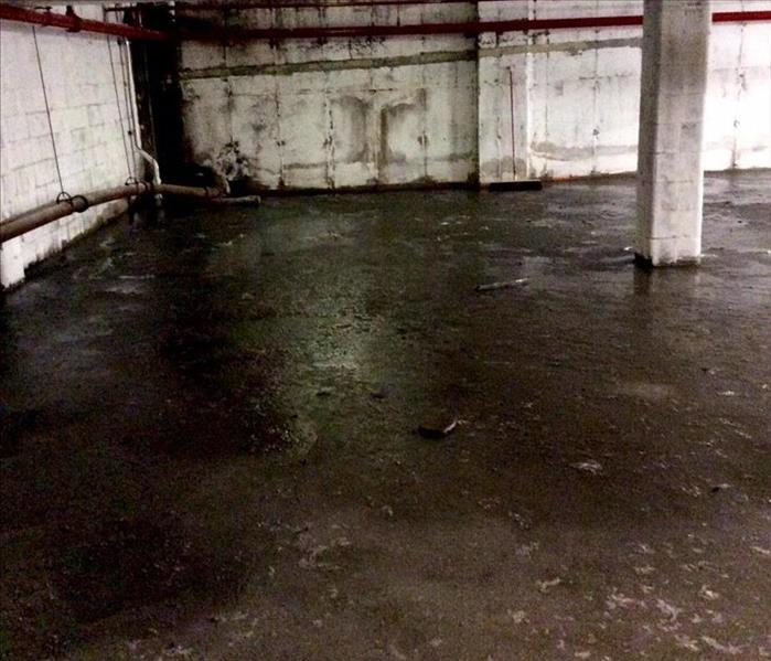 Sewer Backup In Commercial Basement Before